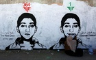 Artist Haifa Subay paints a mural about children's suffering in the time of war as part of the 'Silent Victims' campaign in Sanaa, Yemen November 20, 2017. REUTERS