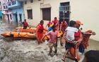 Members of National Disaster Response Force, NDRF evacuate people to safer places from a flooded area in Udham Singh Nagar in the northern state of Uttarakhand, India, Oct 19, 2021. National Disaster Response Force/Handout via REUTERS