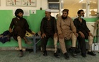A Taliban fighter Mohammad Ishaq sits with other patients during a session to get used to his new leg prothesis at a rehabilitation centre in Kabul, Afghanistan October 12, 2021. REUTERS