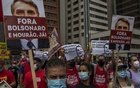 """FILE — A protest against Jair Bolsonaro, the Brazilian president, in São Paulo, Oct 2, 2021. Senators on the 11-member Brazilian congressional panel had second thoughts about the provability of homicide and genocide charges — instead, they accused the president of """"crimes against humanity."""" (Victor Moriyama/The New York Times)"""