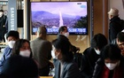 People watch a TV broadcasting file footage of a news report on North Korea firing a ballistic missile off its east coast, in Seoul, South Korea, October 19, 2021. REUTERS/Kim Hong-Ji