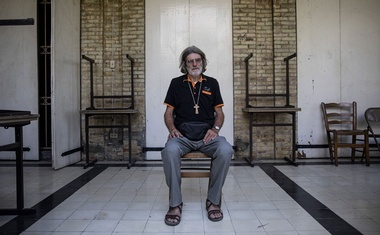 The Rev. Michel Briand, who was kidnapped in April with nine others, in Port-au-Prince, Haiti, Oct. 20, 2021. In a country where crime has run rampant and jobs are scarce, a growing number of young men are joining gangs, Father Briand said. (Adriana Zehbrauskas/The New York Times)