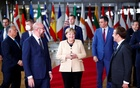 European Council President Charles Michel, German Chancellor Angela Merkel, French President Emmanuel Macron and members of the European Council pose for a family photo during a face-to-face EU summit in Brussels, Belgium, Oct 21, 2021. REUTERS