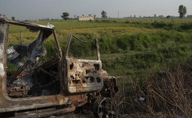 The charred wreckage on Oct 7, 2021, of a vehicle that mowed down protesters in Lakhimpur Kheri, India, and was subsequently set afire by an angry crowd. A year on, protesters against the country's agricultural laws are taking an increasingly confrontational approach with the country's leaders. Saumya Khandelwal/The New York Times