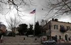 An American flag flutters at the premises of the former United States Consulate General in Jerusalem March 4, 2019. REUTERS/Ammar Awad
