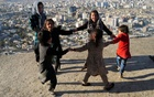 Children play outside their house at Tv mountain in Kabul, Afghanistan October 15, 2021. REUTERS