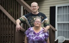 James Watts, who worked at Amazon in Chattanooga for six years before repeated heart attacks and strokes forced him to go on disability leave, sits with his wife Mary Ann outside their home in Dalton, Ga on July 26, 2021. The Watts sold their wedding rings to pay bills. A knot of problems with Amazon's system for handling paid and unpaid leaves has led to devastating consequences for workers. The New York Times