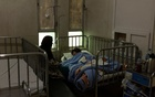 A family is seen at the intensive care unit at the Indira Gandhi hospital in Kabul, Afghanistan October 24, 2021. Picture taken October 24, 2021. REUTERS/Stringer