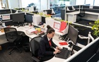 Maddison Thomas, a business manager at MSS Security provider, works in the company's mostly empty office following an extended coronavirus disease (COVID-19) lockdown in Sydney, Australia, October 26, 2021. REUTERS