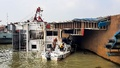 A ferry, named 'Shah Amanat', lies capsized in the Padma River near Paturia's No. 5 terminal in Manikganj. The vessel, loaded with several vehicles and passengers, was headed to the wharf from Rajbari's Daulatdia when it overturned.