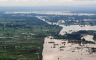 A general view shows a dyke holding flood waters, as River Nzoia burst its banks due to heavy rainfall and the backflow from Lake Victoria, in Budalangi within Busia County, Kenya May 3, 2020. REUTERS/Thomas Mukoya