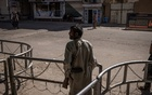 A guard on Oct 18, 2021, at a Shiite mosque in Kandahar, Afghanistan, that was bombed by the Islamic State group. Iran is worried that the Taliban are unwilling or unable to prevent such attacks.The New York Times