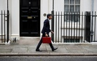 Britain's Chancellor of the Exchequer Rishi Sunak carries the budget box outside Downing Street in London, Britain, October 27, 2021. REUTERS/Peter Nicholls