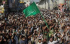 Supporters of the banned Islamist political party Tehrik-e-Labaik Pakistan (TLP) chant slogans demanding the release of their leader and the expulsion of the French ambassador over cartoons depicting the Prophet Mohammed, during a protest rally in Lahore, Pakistan October 22, 2021. Reuters