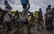 People trying to cross a barricade set up during a strike in Cabaret, Haiti on Oct 23, 2021. The New York Times.