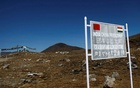 A signboard is seen from the Indian side of the Indo-China border at Bumla, in the northeastern Indian state of Arunachal Pradesh, November 11, 2009. REUTERS